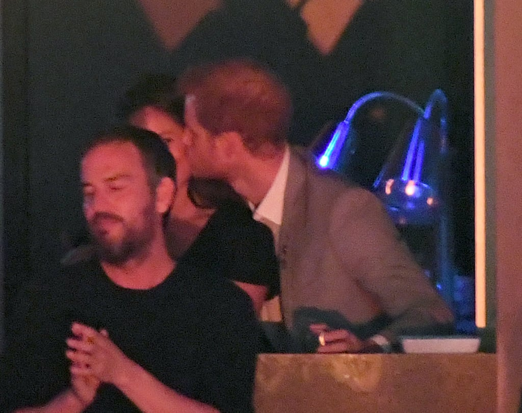 Prince Harry's annual Invictus Games came to a close on Saturday night, and after giving an impassioned speech to the crowd of participants and spectators, the proud royal retreated to a private area where he was spotted getting cozy with his girlfriend, actress Meghan Markle. The lovebirds were all smiles in the stands, and at one point Harry planted a sweet kiss on Meghan's cheek. They were also joined by Meghan's mother, Doria, who is an LA-based clinical therapist and yoga teacher. We first got a glimpse of Harry and Meghan together last week during a wheelchair tennis event; they held hands while arriving and kept close while cheering on the athletes. While engagement rumors continue to swirl around Meghan and Harry, it's possible that the birth of his new niece or nephew could push back any wedding plans. Prince William and Kate Middleton's third child is due in Spring 2018, and because Harry is very likely to want his brother and sister-in-law involved in his big day, a royal wedding wouldn't happen until Summer, at the earliest. Until Meghan gets a ring on her finger and becomes a part of Britain's most famous family, we'll just have to settle for adorable PDA moments like these.  https://me.popsugar.com/fashion/What-Would-Meghan-Markle-Engagement-Ring-Look-Like-43600354