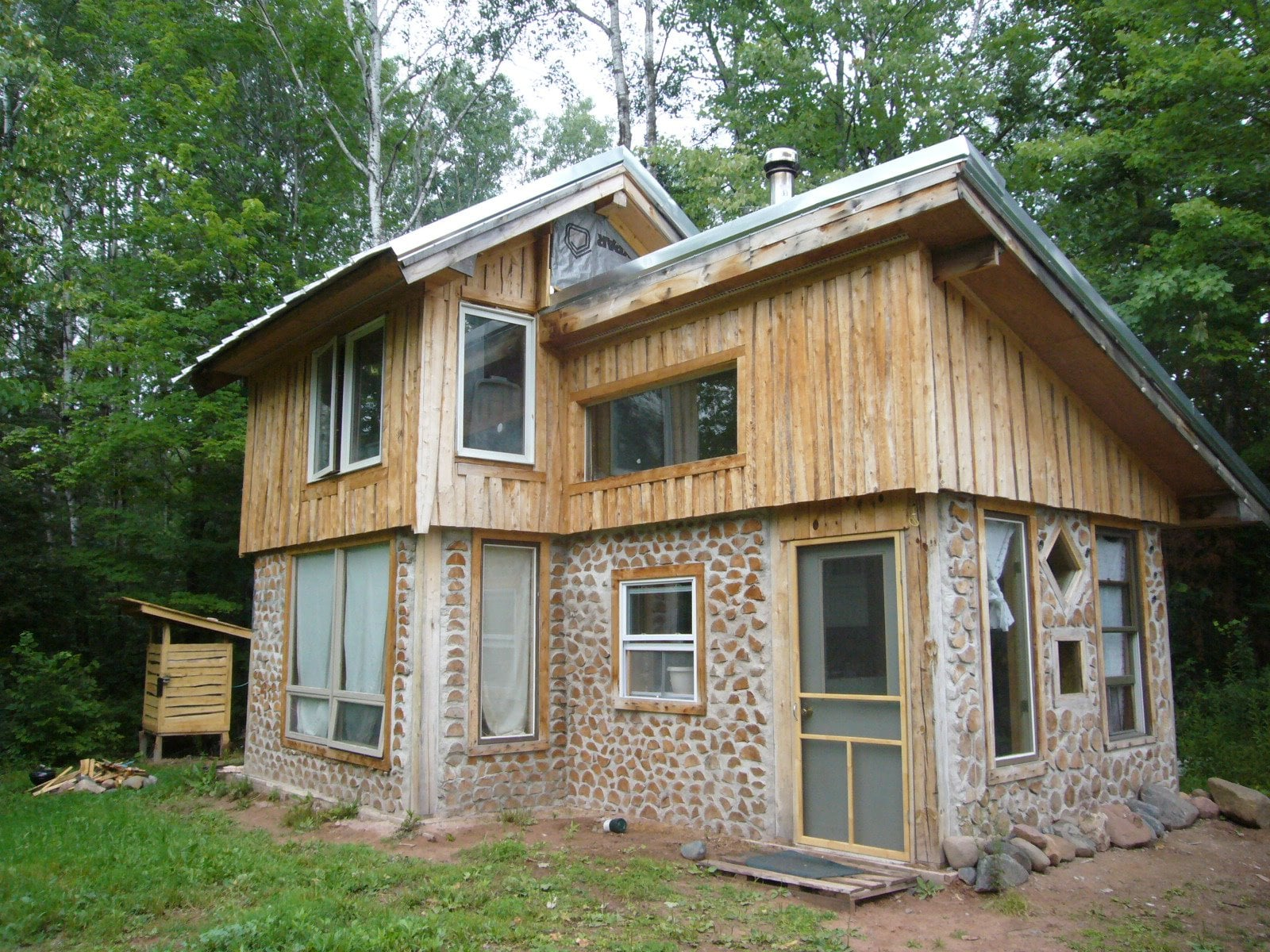 This tiny home was built several years ago using green building principles and DIY ingenuity. You can read about the process here and here.