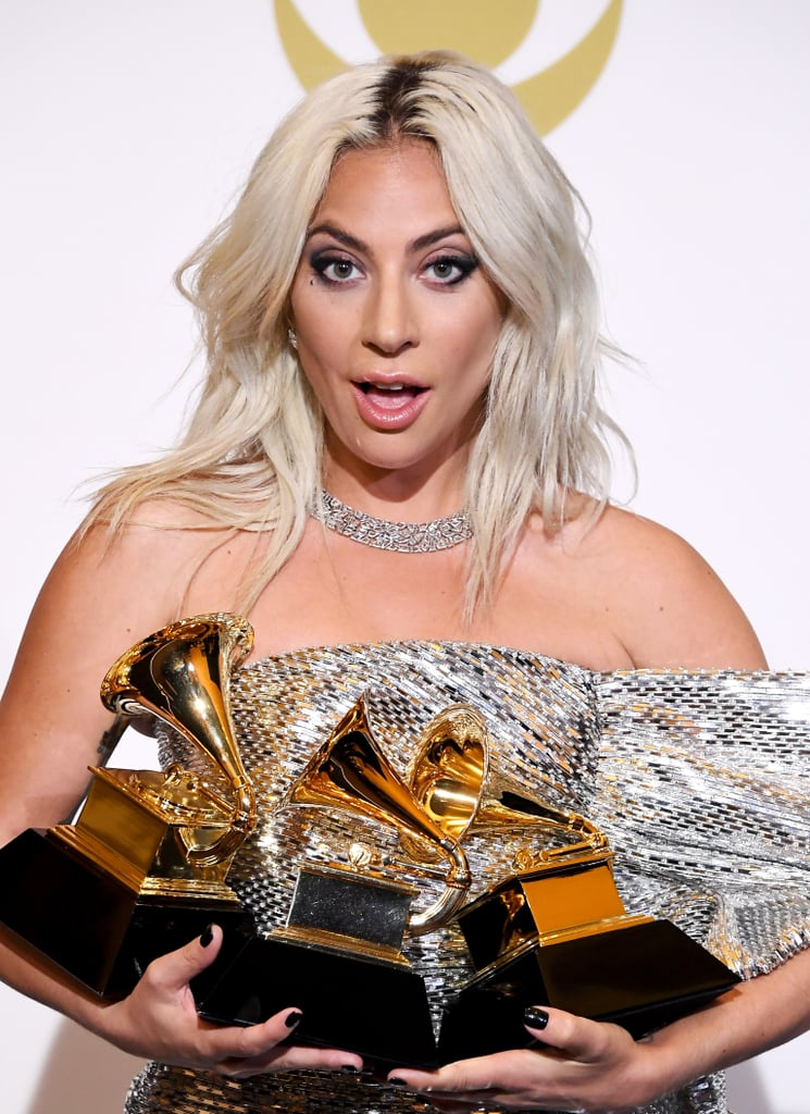 """Lady Gaga is in her element. After previously attending the Golden Globes, Critics' Choice Awards, and Screen Actors Guild Awards for A Star Is Born's award season run, she reunited with the music industry at the 2019 Grammys on Feb. 10. In addition to performing at the award show, Gaga received five nominations this year, including record of the year for """"Shallow.""""  In a very casual turn of events, Gaga won two awards before even hitting the red carpet. """"Shallow"""" earned her the award for best song written for visual media, while she also nabbed the best pop solo performance award for her recent piano reimagining of 2016's """"Joanne."""" In true fashion, Gaga shared a few emotional tweets following her early wins. """"I'm not gonna be able to wear any makeup tonight,"""" she said. """"I'm in tears with honor and gratitude."""" Once the show got started, Gaga tearfully accepted the award for best pop duo/group performance. Hang in there, Gaga — there's still the Oscars! See highlights from her exciting evening ahead.      Related:                                                                                                           Here's How Many Grammys Lady Gaga Has —Including Her 2019 Wins!"""
