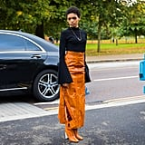 Just like you'd wear black boots with a black skirt, why not do the same but with orange? This style star kept things basic on top, but colorful on the bottom.
