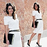 Give your work-appropriate LWD a sophisticated twist. A sleek black clutch and studded black belt should do the trick.
