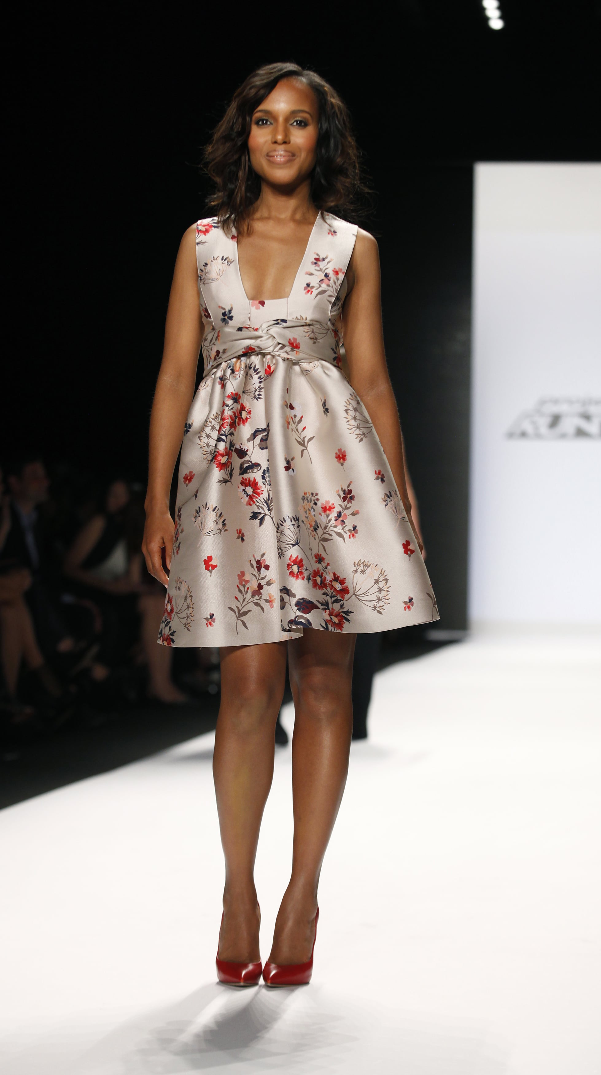 During New York Fashion Week, Washington walked down the catwalk at the Project Runway fashion show in a floral printed silk dress.