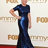 Amy Poehler in a blue gown.