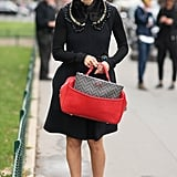 This look got a boost with a host of beautiful accessories — a brilliant red bag and an embellished collar were the stars.