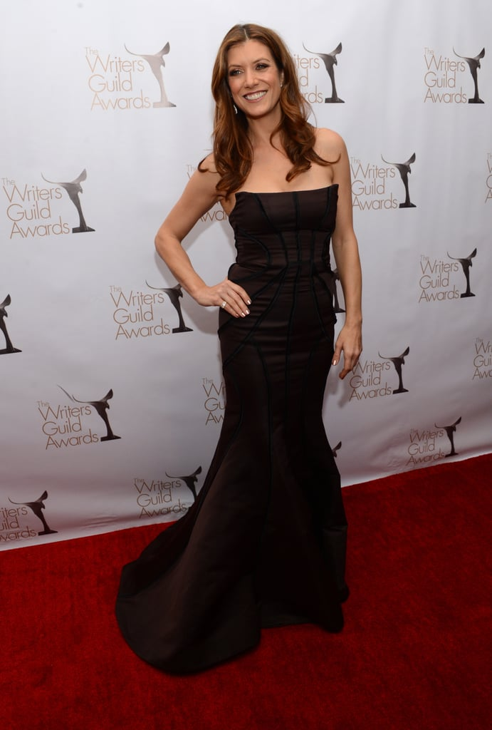 Kate Walsh looked glamorous in a dark-brown strapless mermaid gown featuring a structured corset.