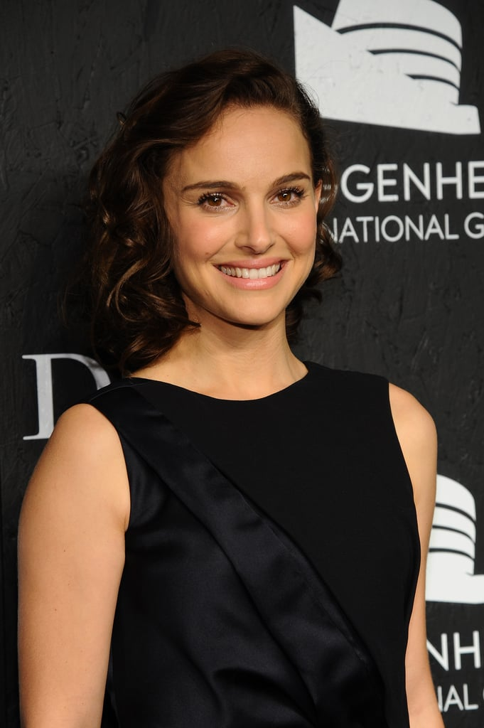 This week, we spotted Natalie Portman at the Guggenheim International Gala debuting a darker hair color with her lob in glossy curls. She went for a feminine makeup palette with blush pink on her lips and cheeks.