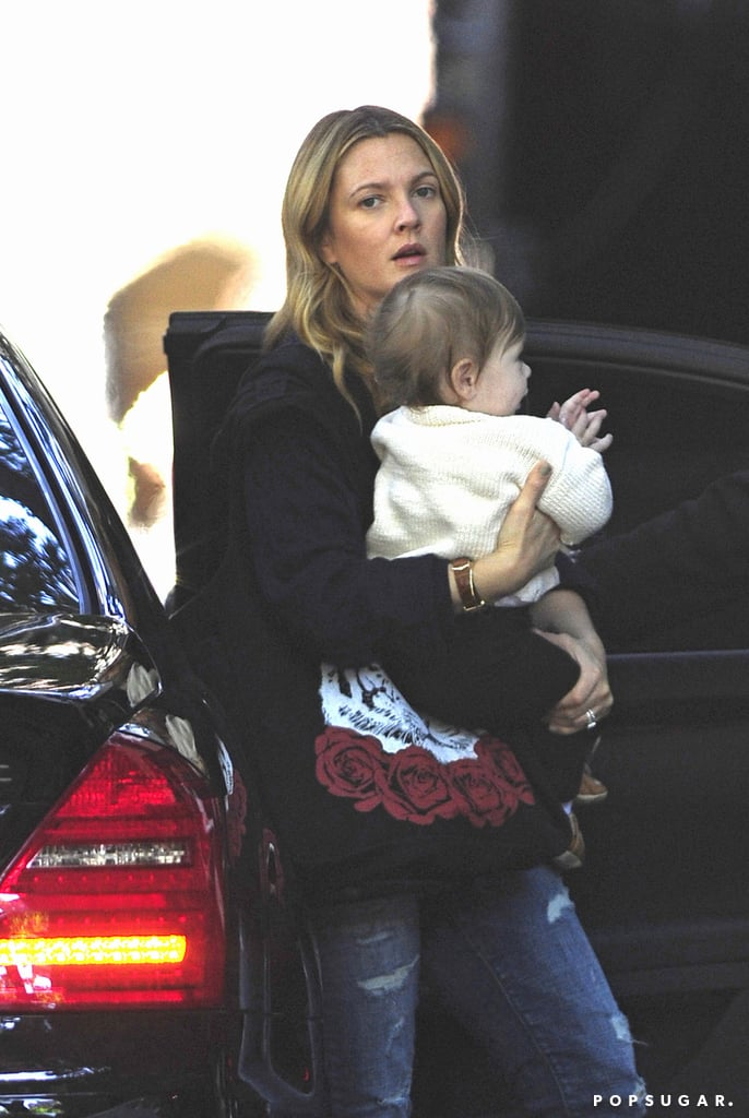 Drew Barrymore carried little Olive during a birthday visit with Jimmy Fallon.