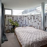 Wooden planks cover the bedroom walls.