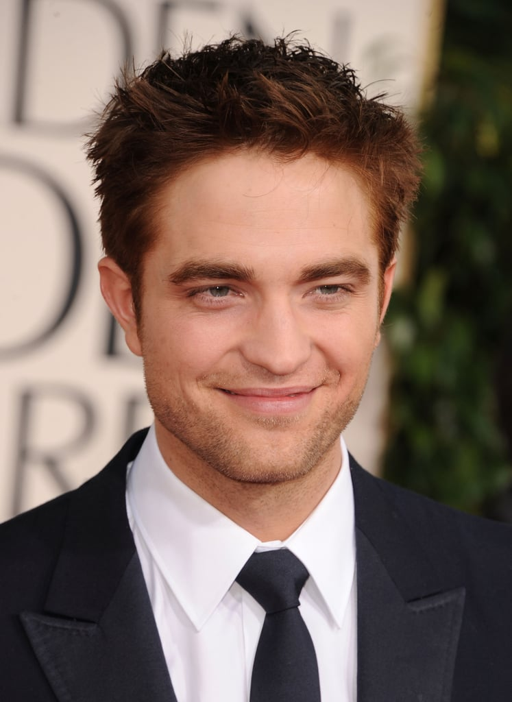 Robert Pattinson brought his sexiest stare to the Golden Globe Awards red carpet last night. He sported a perfectly tailored Gucci suit and a sun-kissed glow from spending this weekend working on Water For Elephants reshoots. He was there last night as a presenter, though he sweetly admitted that he's only seen one of the films in the category he's announcing. Weigh in with all of Fab and Bella's live love it or leave it polls, and stay tuned for lots more from the red carpet!