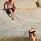 Paris Hilton climbed up the rocks while her mystery man climbed down the rocks to meet halfway.