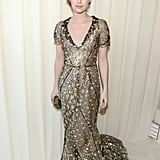 Emma Roberts wore a gilded, custom-made Oscar de la Renta dress to the 21st annual Elton John AIDS Foundation Academy Awards party.