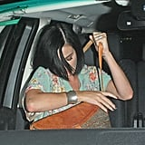 Katy Perry adjusted herself after hopping in the car with John Mayer.