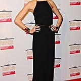 Karlie posed preparty in a long black halter dress and gold cuffs.