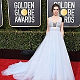 Alison Brie wearing a custom pale blue tulle with a hand embroidered crystal and pearl bustier. She accessorized with Harry Winston jewels.
