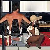 Shirtless Simon Cowell on a yacht.