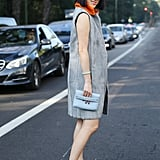 Eva Chen styled her fur vest like a pro with a dress and comfortable sneakers.