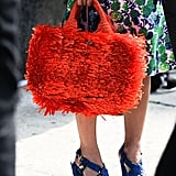 Susie Lau paired her orange Prada raffia with a Marc Jacobs floral print and chunky Louis Vuitton sandals.