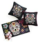 Indoor/Outdoor Pillows ($35) and Skull Doormat ($20)