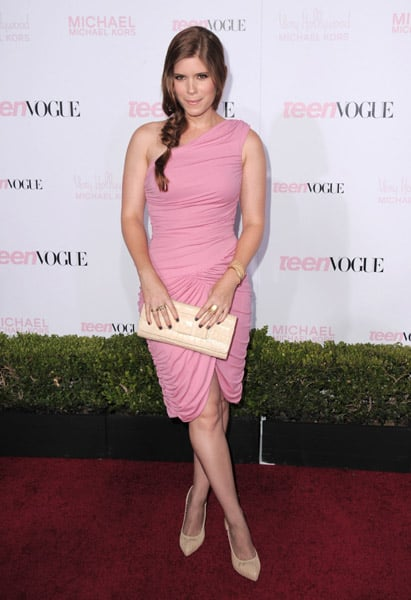 Kate Mara went the sweet route in a Michael Kors rose matte jersey one-shoulder Goddess dress, Michael Kors nude leather pumps, and Michael Kors nude crocodile bow clutch.