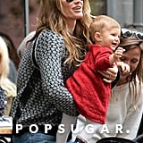 Gisele Bündchen held on to her smiling baby.