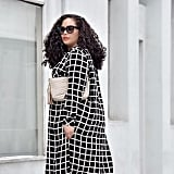 A Floor-Length Checked Jacket With a Purse and Sunglasses