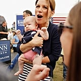 Then-presidential candidate Michele Bachmann held onto a 3-month-old baby while talking to the tot's parents at an August 2011 rally in Humboldt, IA.