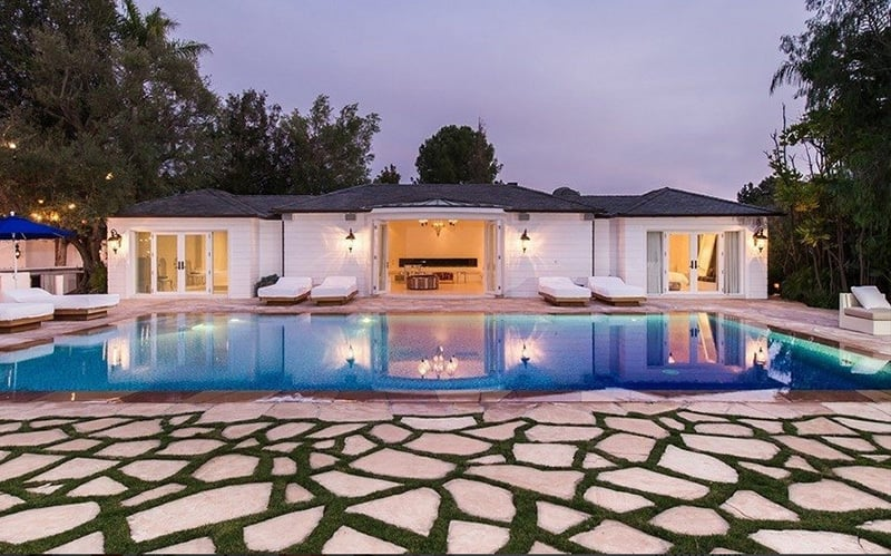 Inside the pool house is a Moroccan bathhouse, complete with sauna, steam shower, and spa.
