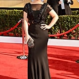 Kelly Osbourne opted for an embellished Jenny Packham gown with sheer caplet sleeves.