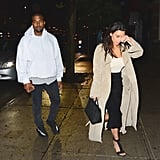 Kim wore a polished black and beige look, and Kanye kept up the neutral theme with a cozy white pullover.