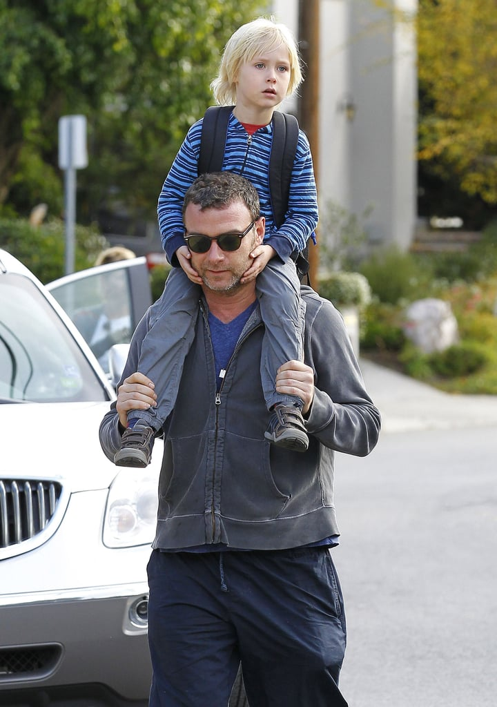 Liev Schreiber walked with Sasha on his shoulders.