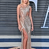 Hailey's Atelier Versace Spring 2017 Couture gown was practically dripping off of her at the Vanity Fair Oscars party in March.