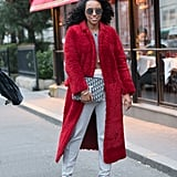 Take your cozy layer to the next level by opting for red outerwear instead of classic black, brown, or navy.