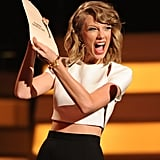Taylor Swift looked excited while announcing a winner at the ACM Awards.