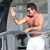 Simon Cowell greeted someone from his yacht in France in August 2012.