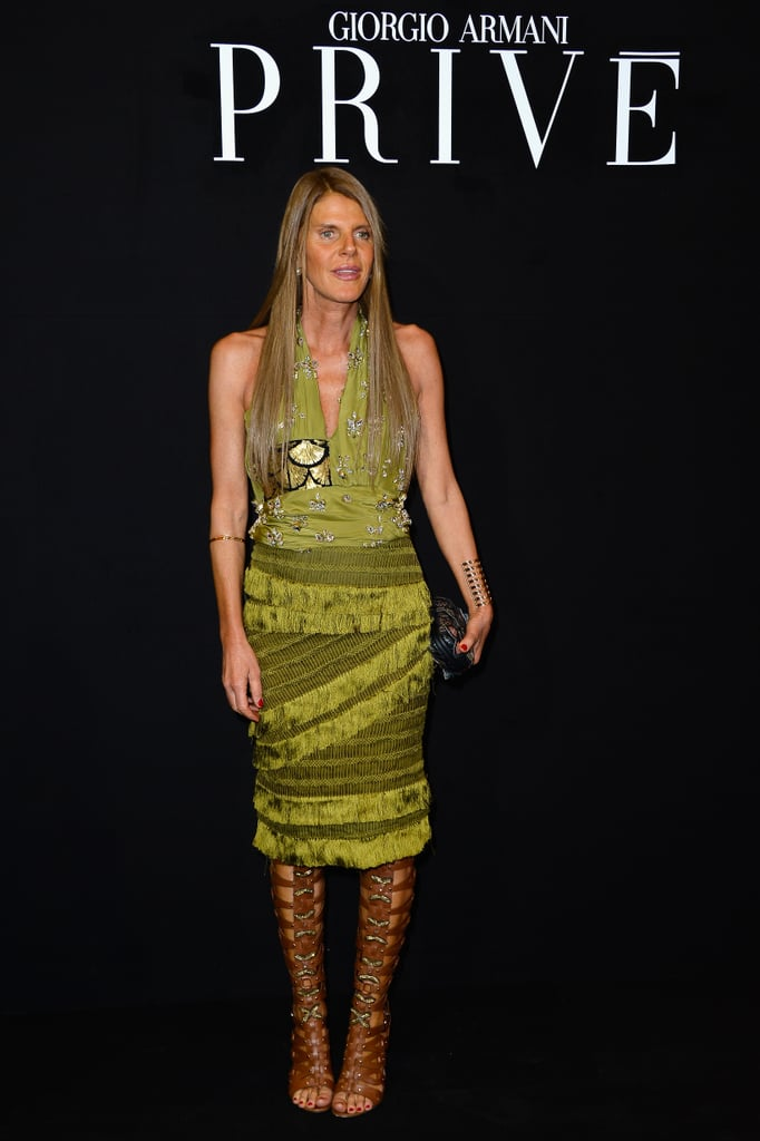 Anna Dello Russo couldn't be missed in the front row of Armani Privé in a bright, fringed ensemble.