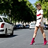 Swap heels for a killer pair of boots when your hemline is hanging high.