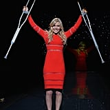 Lindsey Vonn raised her crutches in a Cynthia Rowley dress during the Heart Truth Red Dress Collection show on Thursday.