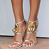 Anais Monory wore a pair of gold-and-silver strapped sandals.