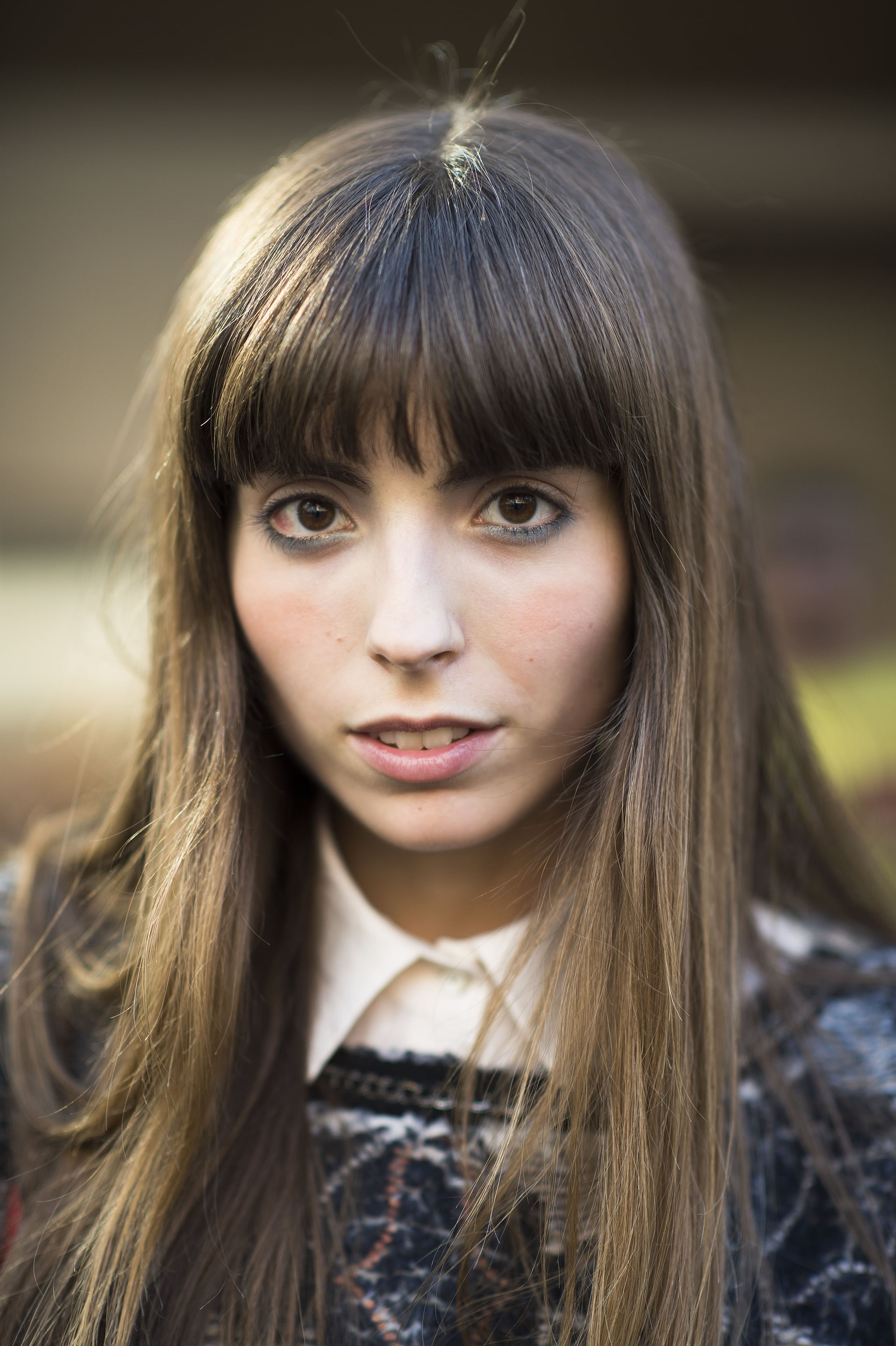 This girl's bangs drew serious attention to the icy blue shadow swept under her eyes. Source: Le 21ème   Adam Katz Sinding