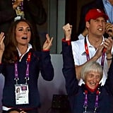 The duke and duchess cheered on the team.