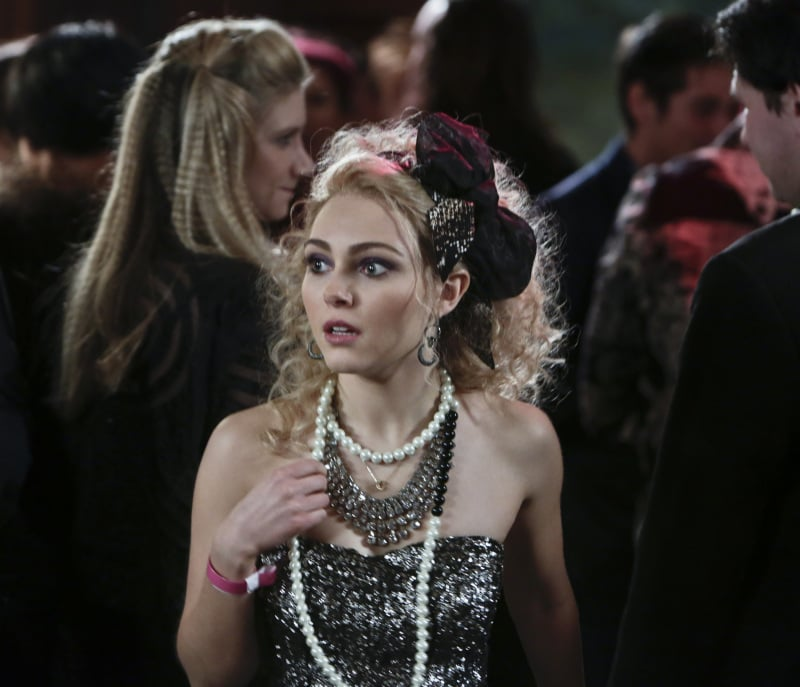 Carrie channelled her inner material girl in a strapless sequin confection, a bevy of statement necklaces, and an 80s-approved headband.  Source: The CW