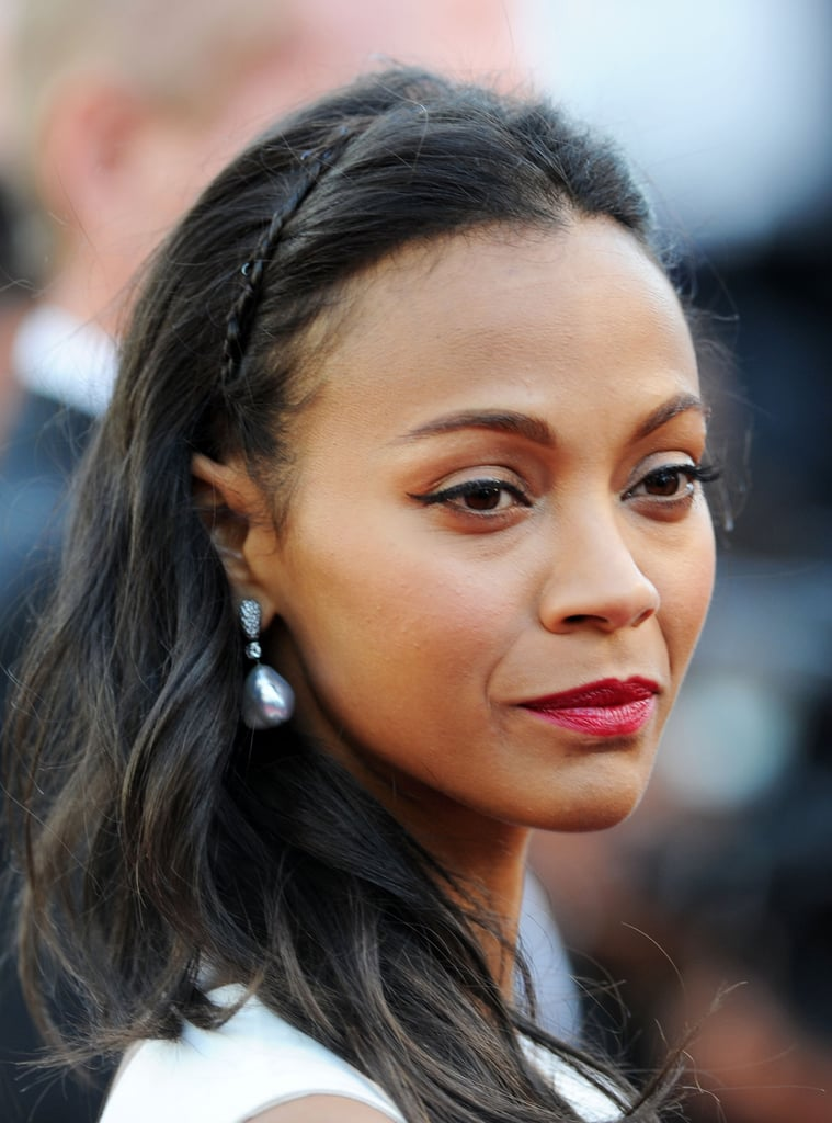 "Zoe Saldana's ""headband,"" which she donned at the Cannes Film Festival, was a petite braid formed from her own hair."