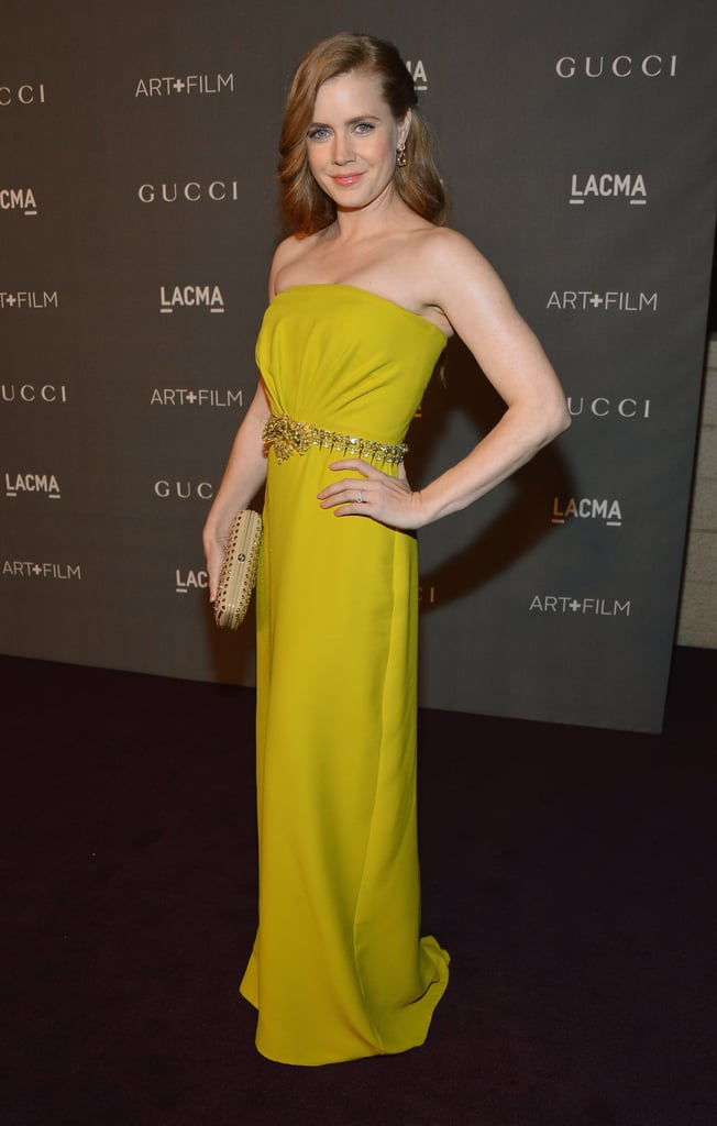 Amy Adams brought the color on a bright strapless gown, adorned with an embellished belt at the waist.