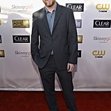 Joss Whedon wore sneakers on the red carpet.