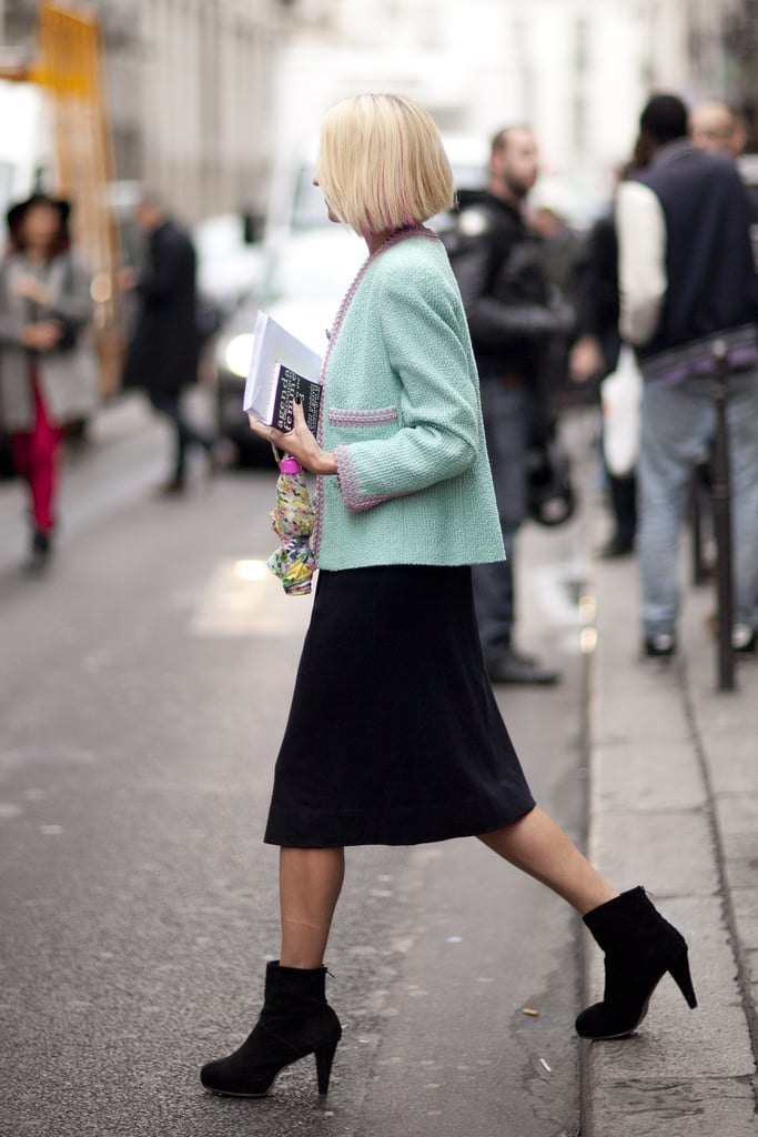 It's all about the play on striking proportions here — a cropped jacket, a knee-length skirt, and a boxy ankle-cut boot work well together.