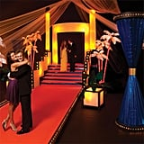"""Project Prom-Way The reality competition show Project Runway inspired this theme, which includes """"Look Like a Celebrity"""" column and """"Strike a Pose"""" palm trees. It just needs Heidi Klum to complete the setup. Auf wiedersehen!"""