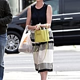 On Tuesday, Anne Hathaway smiled while getting lunch in LA.