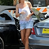 Heidi Klum matched a white lace tank with denim cutoffs during a daytime outing in LA.