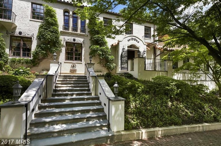 """Kellyanne Conway, counselor to President Donald Trump, is the presumed new owner of one of the most expensive residential properties in DC: a massive 15,000-square-foot, eight-bedroom, $8 million mansion. The elegant home was formerly owned by the prime minister of Pakistan and is located in a secluded neighborhood, perfect for diplomats or those needing high security. In fact, Hillary Clinton owns a home less than half a mile away.  After a long day in the White House, Kellyanne can unwind in her library, go for a swim in her pool, retreat to her cabana or – if she's feeling especially tired – eschew the stairs in favor of the home's private elevator between floors. The over-the-top master bath includes two full bathrooms, double closets, and a separate sitting area.  For entertaining, there's a billiards room, exercise room, and wine cellar. In addition to a family kitchen, the home also has a catering kitchen, so if Kelly doesn't want to cook for guests, she can have staff come in to prepare meals for her. And with multiple rooms specifically devoted to staff quarters, there's plenty of space for live-in help.  Eugene """"Stewart"""" Coleman of Coldwell Banker was the listing agent. Check out this ultraluxurious property for yourself ahead."""