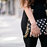 Polka dots in hand on her Comme des Garcons clutch.